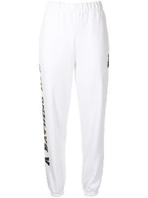 A BATHING APE® camouflage-print patch pocket track pants