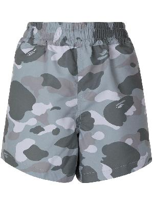 A BATHING APE® camouflage print track shorts