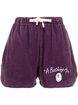 A BATHING APE® embroidered logo track shorts