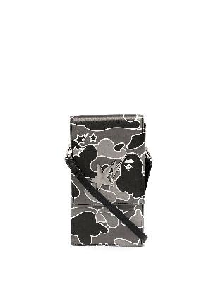 A BATHING APE® camouflage phone holder