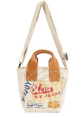 Aleah small printed canvas top handle bag